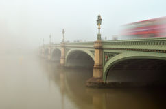 Westminster Bridge in fog. A thick fog envelops Westminster Bridge and Big Ben and the Houses of Parliament disappear shrouded in fog Stock Image