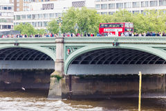 Westminster Bridge. Many people walk across the bridge as it is a huge tourist attraction royalty free stock image