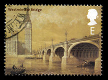 Westminster Bridge UK Postage Stamp. UNITED KINGDOM - 2002: A Postage Stamp from the UK containing a vintage image of Westminster Bridge and the Houses of Royalty Free Stock Photos