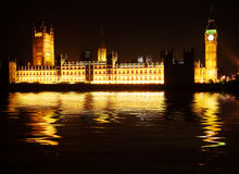 Westminster - houses of parliament. Reflected in the Thames at night Royalty Free Stock Image