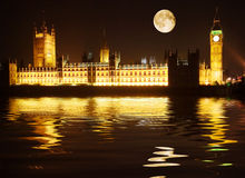 Westminster - houses of parliament. Reflected in the Thames at night Royalty Free Stock Photography