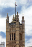 Westminster parliament, detail. Part of Victoria tower, London, UK Royalty Free Stock Photography