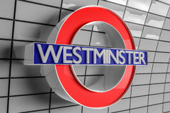 Westminster Tube Sign. Westminster Underground tube sign set agains a white tiled background Stock Photos