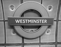 Westminster tube station roundel in London black and white. LONDON, UK - CIRCA JUNE 2017: Westminster tube station roundel in black and white Stock Image
