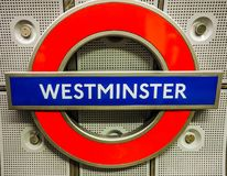 Westminster tube station roundel in London (hdr). LONDON, UK - CIRCA JUNE 2017: Westminster tube station roundel (high dynamic range Royalty Free Stock Image