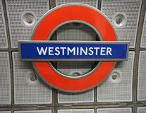 Westminster tube station roundel in London. LONDON, UK - CIRCA JUNE 2017: Westminster tube station roundel Royalty Free Stock Image