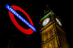 Westminster Underground, Big Ben. View of the Big Ben underneath the Westminster Underground sign one night Royalty Free Stock Image