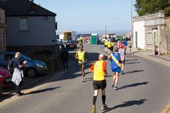 Weston Super half marathon at Weston-super-Mare, Somerset on Sunday 24th March 2019 runners at Birnbeck Rd