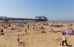 Weston-super-mare beach and pier busy with families on the beautiful May bank holiday weekend Stock Photos