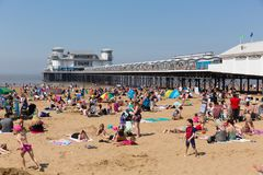 Weston-super-mare beach and pier busy with families enjoying the beautiful May bank holiday weekend Royalty Free Stock Photos