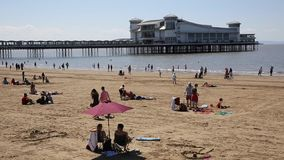 Weston-super-Mare beach and pier Somerset in summer sun with tourists and holidaymakers stock footage