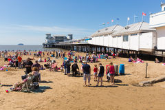 Weston-super-Mare beach and pier Somerset in summer sunshine with tourists and visitors. Beautiful summer sunshine and warm weather drew visitors to the seaside Royalty Free Stock Photography