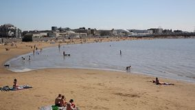 Weston-super-Mare beach Somerset in August summer sunshine with people stock footage