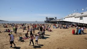 Weston-super-Mare beach Somerset in summer sunshine with tourists and holidaymakers stock video