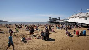 Weston-super-Mare beach Somerset in summer sunshine with tourists and holidaymakers PAN stock footage