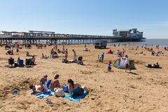 Weston-super-Mare beach Somerset in summer sunshine with tourists and visitors. Beautiful summer sunshine and warm weather drew visitors to the seaside at Weston Royalty Free Stock Photo