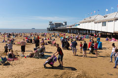 Weston-super-Mare beach Somerset in summer sunshine with tourists and visitors. Beautiful summer sunshine and warm weather drew visitors to the seaside at Weston Stock Images