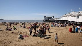 Weston-super-Mare pier and beach Somerset in summer sunshine with visitors and holidaymakers stock video