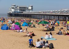 Weston-super-mare Somerset with crowded beach and pier on the beautiful May bank holiday weekend. Beautiful sunshine and warm weather drew visitors to the Stock Images