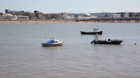 Weston-super-Mare Somerset in summer with boats and the pier PAN stock footage