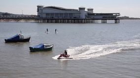 Weston-super-Mare Somerset in summer sunshine with jetski and pier stock footage