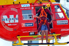 Westpac Rescue Helicopter crew in rescue mission Royalty Free Stock Photography