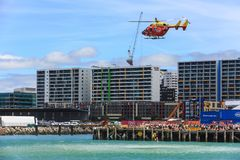 A rescue helicopter carries out a simulated rescue in Auckland, New Zealand royalty free stock images