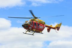Search and rescue helicopter in the air, Auckland, New Zealand. The Westpac Rescue Helicopter, a search and rescue and air ambulance chopper in the skies over stock image