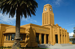 Westport clock tower. Westport's iconic clock tower and council chambers building overlooks the town centre, West Coast, New Zealand Stock Photo