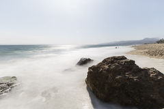 Westward Beach with Motion Blur in Malibu California. Westward beach rocks and waves with motion blur at Point Dume in Malibu, California Stock Photography