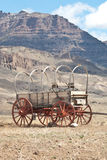 Westward Ho. A Conestoga wagon sits beneath a Wyoming mountain stock image