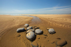 Westward Ho Beach scene with large rocks Royalty Free Stock Photo