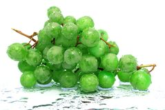 Wet. Green grapes on glass Royalty Free Stock Photos