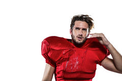 Wet American football player in red jersey looking away Stock Photo