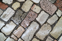 Wet ancient cobblestone floor Stock Photo