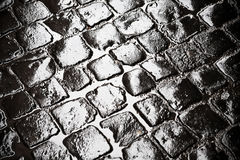 Wet ancient cobblestones Royalty Free Stock Photo