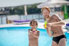 Free Wet And Funny Dad With Son With Water Gun Stock Photography - 192005942