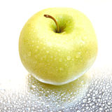 Wet apple. Apple with droplets Royalty Free Stock Photos