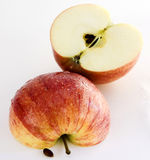 Wet Apple. Isolated Two halfs of a wet apple over white background Royalty Free Stock Photography