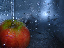 Wet apple. Apple and water Royalty Free Stock Photo