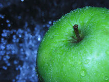 Wet apple. Apple with moisture drops royalty free stock images