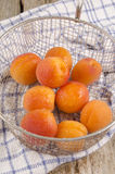 Wet apricots are prepared to make jam Stock Photography
