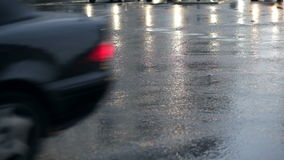Wet asphalt, cars and light reflections stock video footage