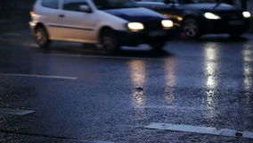 Wet asphalt, cars and light reflections stock footage
