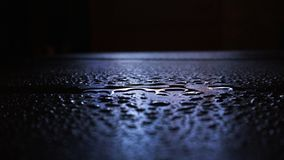 Wet asphalt, night scene of an empty street with a little reflection in the water royalty free stock photos