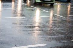 Wet asphalt. Raining in the city detail Royalty Free Stock Photos