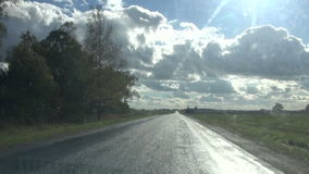 Wet asphalt road and car window after rain stock video footage