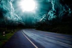 Wet asphalt road curve. Reflect meadow green horizon natural cloudscape sun sky stock photos