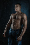 Wet athlete body bodybuilder in the rain. Stock Photography