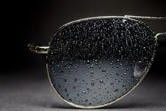 Wet aviator sunglasses Stock Photography